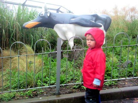 Reuben beside the Penguin Cow sculpture at Edinburgh Zoo