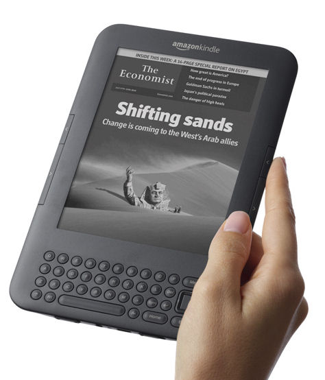 Right-hand holding an Amazon Kindle (e-book reader)