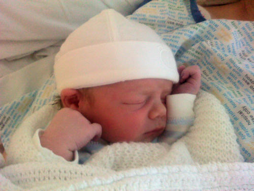 Baby Isaac wearing a white hat
