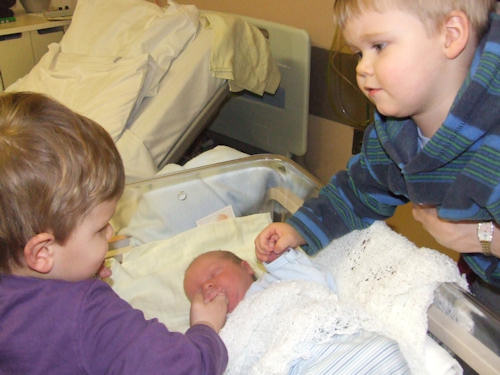 Reuben and Joshua holding hands with Isaac
