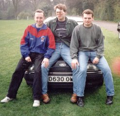 Danny Curtis, Gareth Saunders and Jonny Grocock sitting on a car in 1993