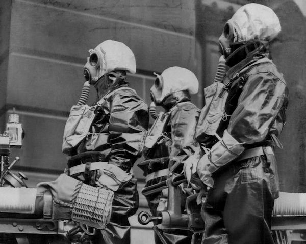 Three fireman photographed in Birmingham, England in 1938 donned in gas masks.