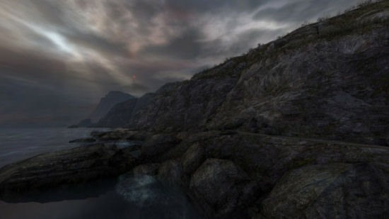 A scene from Dear Esther, on the shoreline with the beacon in the distance.