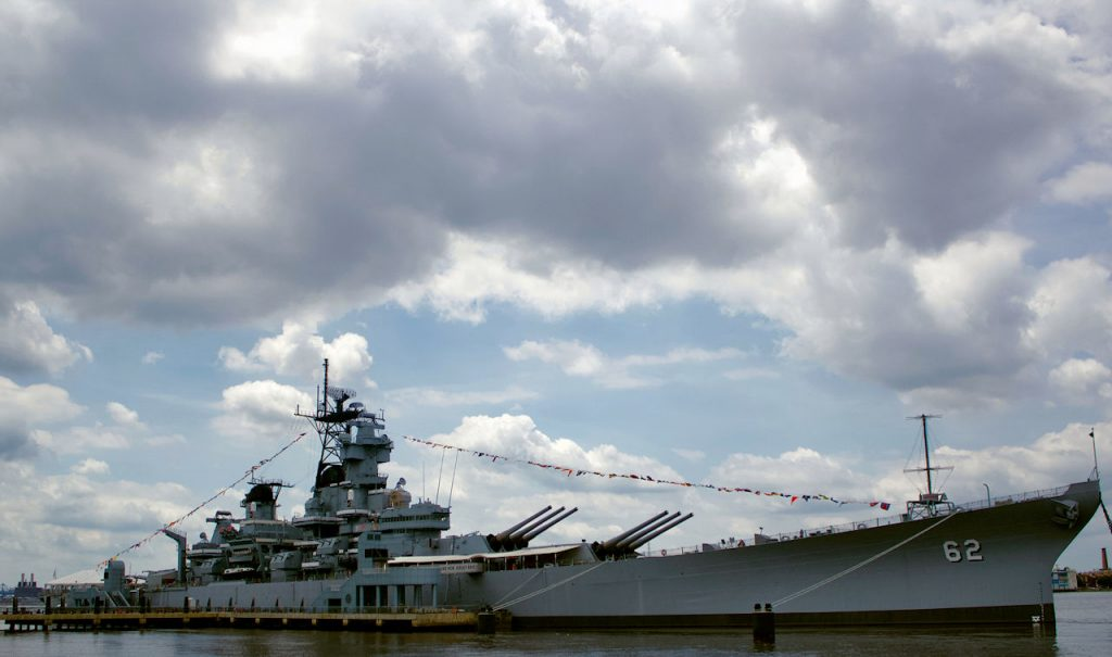 Battleship beneath a grey cloudy sky