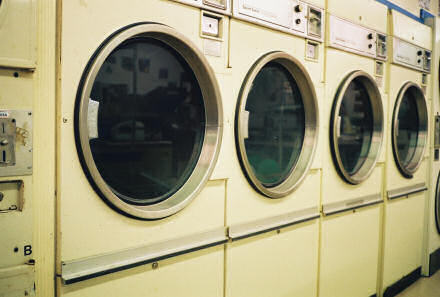 Row of washing machines at a laundrette.