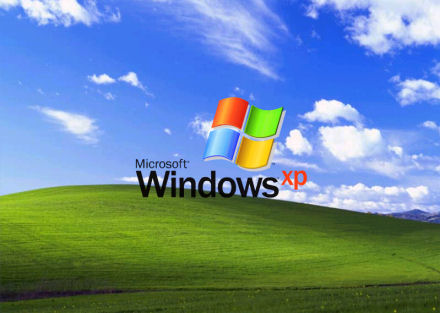 Windows XP desktop shows a green field and a clear blue sky with a few clouds